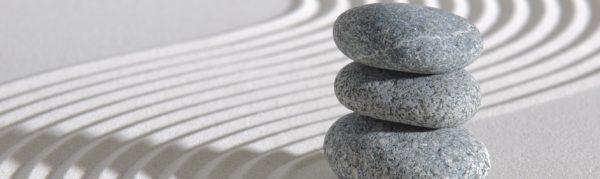 Smooth stones stacked in Zen raked garden